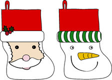 Christmas stockings. Cartoon illustration of two Christmas stockings, one with a Santa Claus face and another with a snowman Royalty Free Stock Image