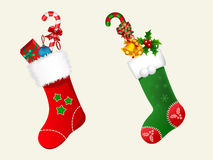 Christmas Stockings. Cute Christmas stockings with pretty gifts Stock Photos