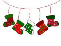 Christmas stockings. Illustration of five decorative Christmas stockings hanging from line, white background Royalty Free Stock Photography
