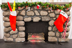 Christmas stockings above fireplace Royalty Free Stock Image