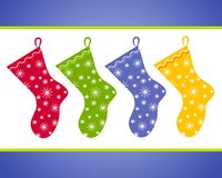 Christmas Stockings Clip Art. A clip art illustration of Christmas Stockings  with decorative snowflake prints in red, green blue and yellow Royalty Free Stock Photography