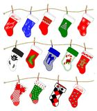 Christmas Stockings. A drawing of fourteen Christmas stockings in various holiday designs fastened to clotheslines with clothespins Royalty Free Stock Image