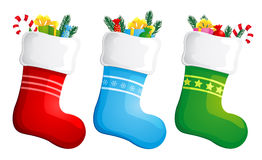 Christmas stockings. Stockings filled with christmas presents Stock Photography