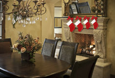 Christmas stockings on fireplace mantel Royalty Free Stock Photography
