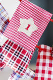 Christmas Stockings for gifts hanging on red rope - close up Royalty Free Stock Images