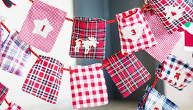 Christmas Stockings for gifts hanging on red rope Royalty Free Stock Photos