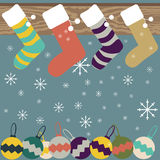Christmas stockings hanging on mantel festive background. Christmas and New Year festive background of Christmas stockings hanging on mantel, snowflakes and Royalty Free Stock Image