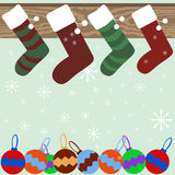 Christmas stockings on mantel with snowflakes and Christmas ball. Christmas and New Year festive background of Christmas stockings hanging on mantel, snowflakes Stock Photo