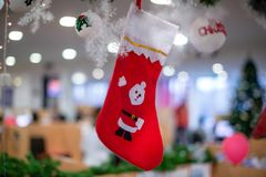Christmas stockings in office Stock Photography