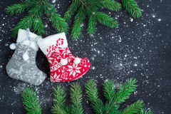 Christmas stockings pair on snowbound black background with fir Royalty Free Stock Photography