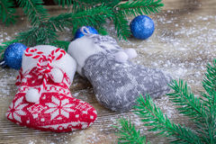 Christmas stockings pair on snowbound wooden background with blu Stock Photography