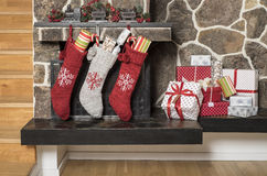 Christmas stockings and presents stock images