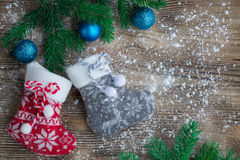 Christmas stockings on snowbound wooden background with blue bal Stock Image