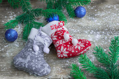 Christmas stockings on snowbound wooden background with blue bal Stock Photography