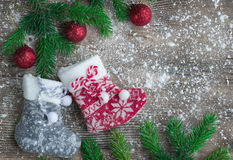 Christmas stockings on snowbound wooden background with red ball Stock Image