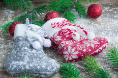 Christmas stockings on snowbound wooden background with red ball Royalty Free Stock Photography