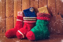 Christmas stockings on wooden background. Vintage style stock photo
