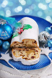 Christmas stollen cake on blue plate Royalty Free Stock Images