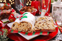 Christmas stollen cake on festive table Royalty Free Stock Images