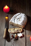 Christmas stollen with candle cinnamon stars nuts on velvet napkin Stock Photos