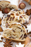 Christmas Stollen with dried fruit, assorted cookies and spices Stock Photo