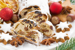Christmas Stollen with dried fruit, cookies and spices on a plat. E, close-up, horizontal Stock Image