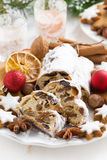 Christmas Stollen with dried fruit, cookies and spices on plate Royalty Free Stock Photography