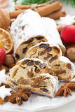 Christmas Stollen with dried fruit, cookies and spices, vertical Stock Images