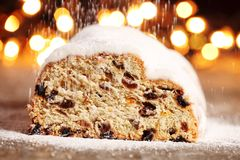 Christmas stollen. And pouring sugar royalty free stock images