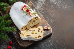 Christmas Stollen. Traditional German, European Festive Dessert. Holiday Concept Decorated with Fir Branches and Cranberries. Selective focus, copy space stock photos