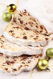 Christmas stollen. Christmas traditional stollen and ornaments close up stock photo