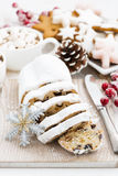 Christmas Stollen on a wooden board and cookies, vertical Royalty Free Stock Image