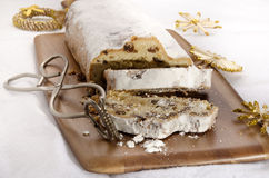 Christmas stollen on wooden board Royalty Free Stock Images