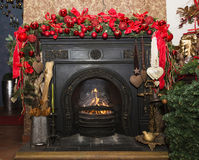 Christmas Stone fireplace with decorations, red and green Stock Photography