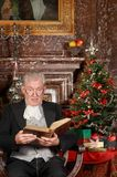 Christmas story in a castle. Victorian grandfather reading the christmas story Royalty Free Stock Image