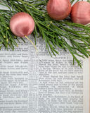 Christmas story and greenery with pink ornaments Royalty Free Stock Photography