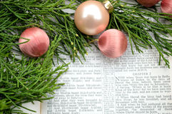 Christmas story and greenery with pink ornaments Stock Photos