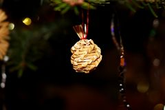 The christmas a straw adornment hanging on the tree. The christmas a straw adornment hanging on the  christmas tree Stock Photos
