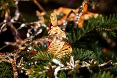 The christmas a straw adornment hanging on the tree. The christmas a straw adornment hanging on the  christmas tree Royalty Free Stock Photography