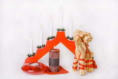 Christmas straw goat, lamp decoration and candles. Christmas straw goat, lamp decoration and two candles royalty free stock images