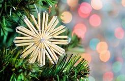 Christmas straw snowflake on fir tree Stock Image