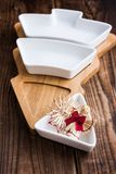 Christmas straw toys and bowl on wood Royalty Free Stock Images
