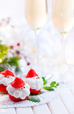 Christmas strawberry Santa. Funny dessert stuffed with whipped cream Stock Images