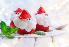 Christmas strawberry Santa. Funny dessert stuffed with whipped cream Stock Photo
