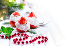 Christmas strawberry Santa. Funny dessert stuffed with whipped cream Royalty Free Stock Photography
