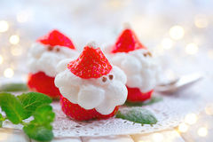 Christmas strawberry Santa. Funny dessert stuffed with whipped cream Stock Photography