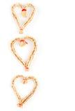 Christmas strawy decorative hearts Stock Photos
