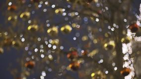 Christmas street decoration. Building, trees in garlands,street decoration. Beautiful Christmas red and yellow decorative balls hanging on the trees against stock video