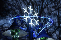 Christmas street  decoration, neon snowflake Stock Photos