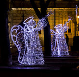 Christmas street decorations - angels playing trumpets made of l Stock Photos